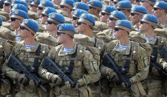 This Aug. 24, 2017, file photo shows Ukrainian soldiers marching along main Khreshchatyk Street during a military parade to celebrate Independence Day in Kiev, Ukraine. The Trump administration has approved a plan to provide lethal weapons to Ukraine, including Javelin anti-tank missiles. That's according to several U.S. officials who weren't authorized to discuss the decision publicly and demanded anonymity Friday, Dec. 22, 2017. (AP Photo/Efrem Lukatsky) **FILE**