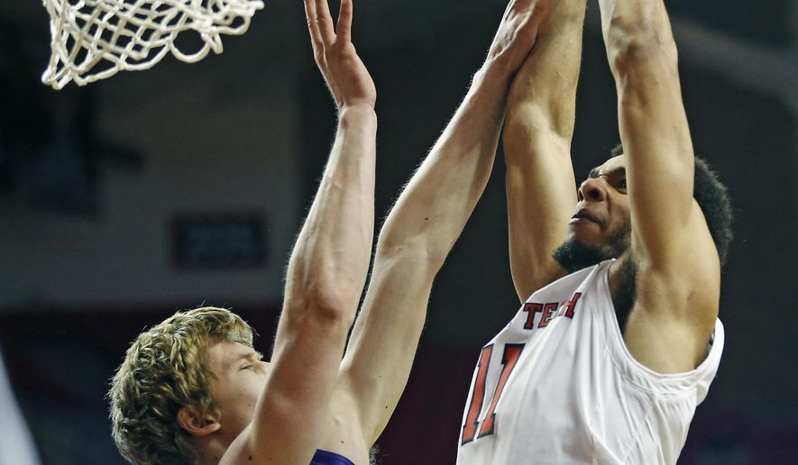 Texas Tech's Zach Smith (11) dunks the ball over Abilene Christian's Hayden Howell (23) during the first half of an NCAA college basketball game Friday, Dec. 22, 2017, in Lubbock, Texas. (AP Photo/Brad Tollefson)