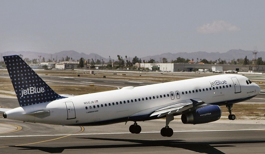 FILE - In this April 18, 2007, file photo, an Airbus A320 JetBlue aircraft lands at the Bob Hope Airport in Burbank, Calif. A JetBlue flight in December 2017 continued to its final destination after three passengers reported a mother mistreating her 8-year-old son, including grabbing him by the neck and shoving him against a window as he cried. Flight crews can restrain passengers or even divert flights when fights or other violent behavior erupts midair, but when the situation involves a parent potentially abusing a child, the decisions are not so clear cut. (AP Photo/Damian Dovarganes, File)