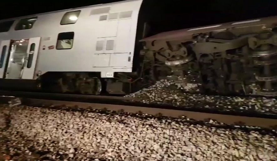 This image taken from video provided to Associated Press on Friday, Dec. 22, 2017 shows one of two passenger trains which collided on Friday at Kritzendorf, near Vienna, Austria, injuring several people, authorities said. The trains, one of them regional and the other local, collided near the station. Several people were injured in the incident. (AP Photo)