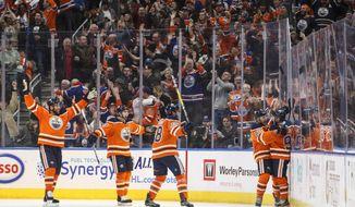 Edmonton Oilers celebrate a goal against the St. Louis Blues during the third period of an NHL hockey game Thursday, Dec. 21, 2017, in Edmonton, Alberta. (Jason Franson/The Canadian Press via AP)