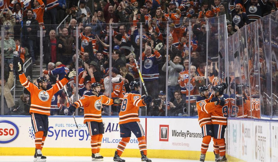 Edmonton Oilers celebrate a goal against the St. Louis Blues during the third period of an NHL hockey game Thursday, Dec. 21, 2017, in Edmonton, Alberta. (Jason Franson/The Canadian Press via AP)