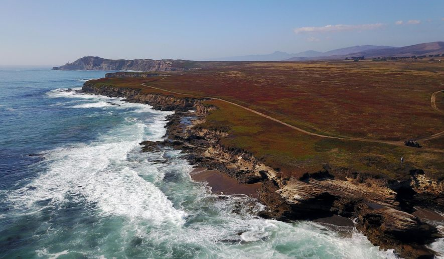 This Oct. 27, 2017 photo provided by The Nature Conservancy shows the coastline near Point Conception, Calif. The nonprofit Nature Conservancy used a $165 million gift to purchase about 24,000 acres of the Cojo-Jalama Ranch on the Santa Barbara County coast in a purchase announced Friday, Dec. 22, 2017. The land approximately 150 miles northwest of Los Angeles will be renamed the Jack and Laura Dangermond Preserve for the entrepreneurs and environmental preservation advocates who donated the money. (The Nature Conservancy via AP)