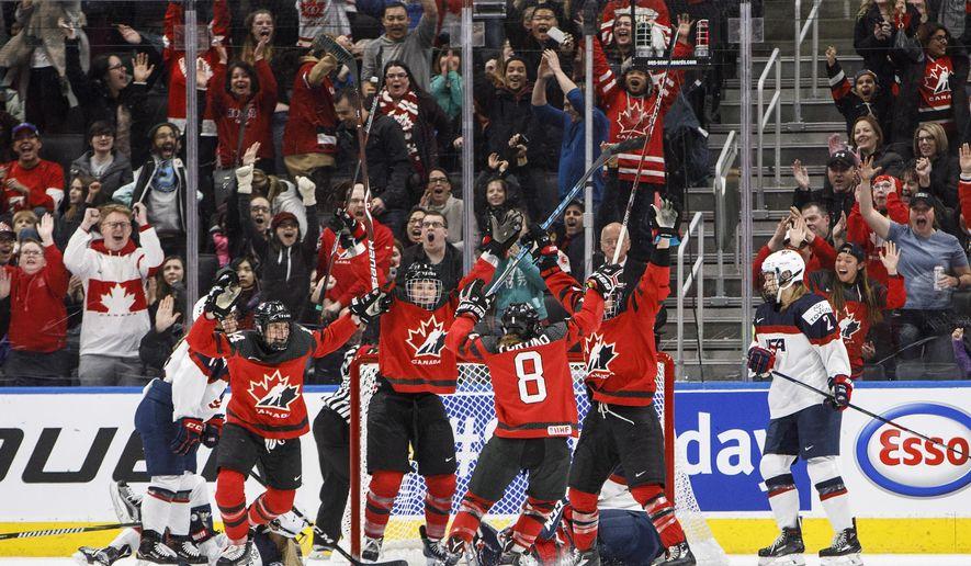 Team Canada celebrates the game winning goal against Team USA during overtime National Women's Team series hockey action in Edmonton, Alberta, on Sunday Dec. 17, 2017. (Jason Franson/The Canadian Press via AP)
