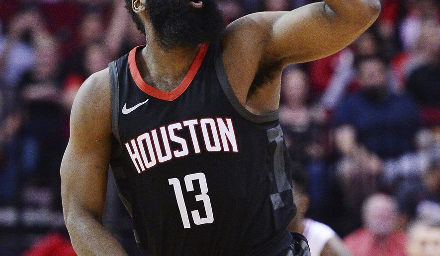 Houston Rockets guard James Harden celebrates a 3-point shot against the Los Angeles Clipers early in an NBA basketball game Friday, Dec. 22, 2017, in Houston. (AP Photo/George Bridges)