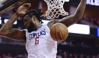 Los Angeles Clippers DeAndre Jordan dunks against the Houston Rockets in the first half of an NBA basketball game Friday, Dec. 22, 2017, in Houston. (AP Photo/George Bridges)