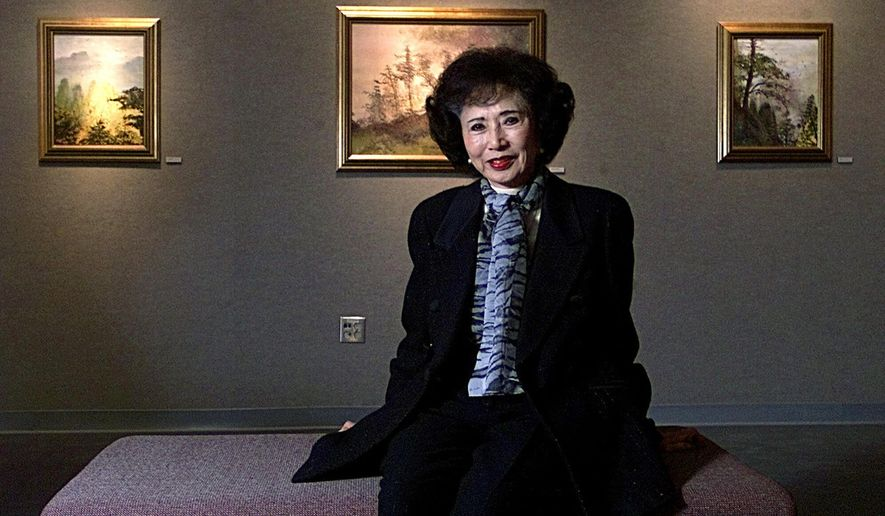 DELETES LAST LINE, PARENTS WHERE NOT IMMIGRANTS -FILE - In this Nov. 28, 2000, file photo, March Fong Eu, former California Secretary of State, is seated among some of her paintings at California State University in Sacramento, Calif. Eu started painting when she studied Chinese language and Chinese brush painting in Taiwan in 1988. March Fong Eu, California's first female secretary of state and former ambassador to Micronesia, died Thursday, Dec. 21, 2017, at the age of 95. Longtime spokeswoman Caren Lagomarsino said that Eu died in Irvine, California, from complications following a fall and subsequent surgery.(AP Photo/Rich Pedroncelli, File)