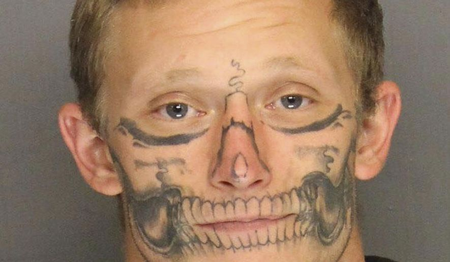 FILE - This undated file photo provided by the San Joaquin County Sheriff's Office shows inmate Corey Hughes. Authorities say that Hughes, who has a skull tattooed on his face and escaped last month from a work crew in central California, was arrested Thursday, Dec. 22, 2017. (San Joaquin County Sheriff's Office via AP, file)