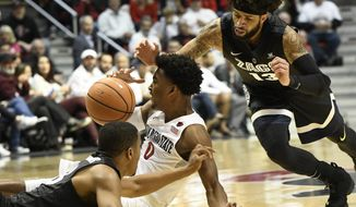 San Diego State forward Max Montana (10) fights for a loose ball with Gonzaga guard Zach Norvell Jr. (23), left, and Gonzaga guard Josh Perkins (13), right, during the first half of an NCAA college basketball game Thursday Dec. 21, 2017, in San Diego. (AP Photo/Denis Poroy)