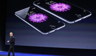 FILE - In this March 9, 2015 file photo, Apple CEO Tim Cook talks about the iPhone 6 and iPhone 6 Plus during an Apple event in San Francisco. IPhone owners from several states sued Apple Inc. for not disclosing sooner that it issued software updates deliberately slowing older-model phones so aging batteries lasted longer, saying Apple's silence led them to wrongly conclude that their only option was to buy newer, pricier iPhones. The allegations were in a lawsuit filed Thursday, Dec. 21, 2017, in Chicago federal court on behalf of five iPhone owners. (AP Photo/Eric Risberg, File)