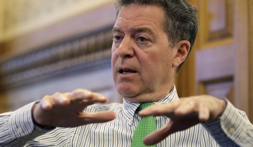 FILE - In this Dec. 19, 2017 file photo, Kansas Gov. Sam Brownback talks about his term as governor during an interview at the Kansas Statehouse in Topeka, Kan. Gov. Brownback's nomination to be U.S. ambassador-at-large for international religious freedom is in limbo after the U.S. Senate failed to vote on it before wrapping up its business for the year. (AP Photo/Charlie Riedel File)