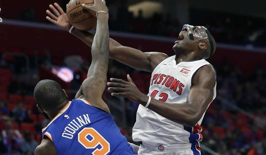 New York Knicks center Kyle O'Quinn (9) blocks a shot by Detroit Pistons forward Anthony Tolliver during the first half of an NBA basketball game, Friday, Dec. 22, 2017, in Detroit. (AP Photo/Carlos Osorio)