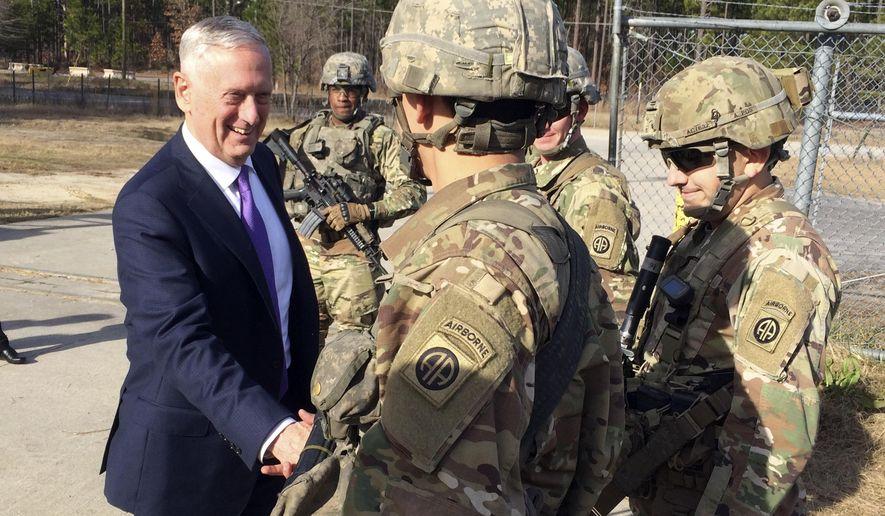 Defense Secretary Jim Mattis  greets soliders at Fort Bragg, N.C., Friday, Dec. 22, 2017. (AP Photo/Robert Burns)