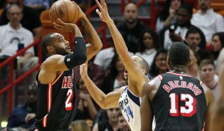 Miami Heat guard Wayne Ellington (2) shoots under pressure from Dallas Mavericks guard Devin Harris (34) in the second quarter of an NBA basketball game, Friday, Dec. 22, 2017, in Miami. (AP Photo/Joe Skipper)