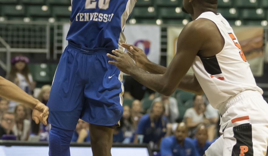 Middle Tennessee guard Giddy Potts (20) shoots while being defended by Princeton guard Amir Bell (5) during the first half of an NCAA college basketball game at the Diamond Head Classic tournament, Friday, Dec. 22, 2017, in Honolulu. (AP Photo/Eugene Tanner)