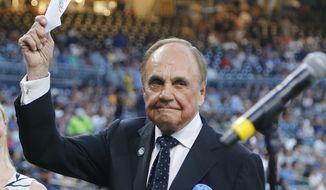 In this Sept. 29, 2016, file photo, San Diego Padres broadcaster Dick Enberg waves to crowd at a retirement ceremony prior to the Padres' final home baseball game of the season, against the Los Angeles Dodgers in San Diego. Enberg, the sportscaster who got his big break with UCLA basketball and went on to call Super Bowls, Olympics, Final Fours and Angels and Padres baseball games, died Thursday, Dec. 21, 2017. He was 82. (AP Photo/Lenny Ignelzi, File)
