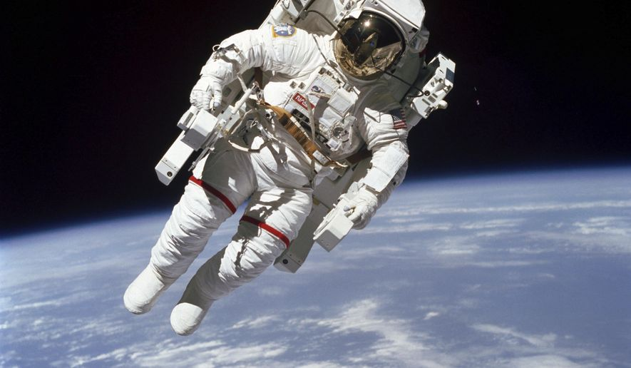 This Feb. 7, 1984 photo made available by NASA shows astronaut Bruce McCandless II, participating in a spacewalk a few meters away from the cabin of the Earth-orbiting space shuttle Challenger, using a nitrogen-propelled Manned Maneuvering Unit. The Johnson Space Center says McCandless died Thursday, Dec. 21, 2017 in California. (NASA via AP)