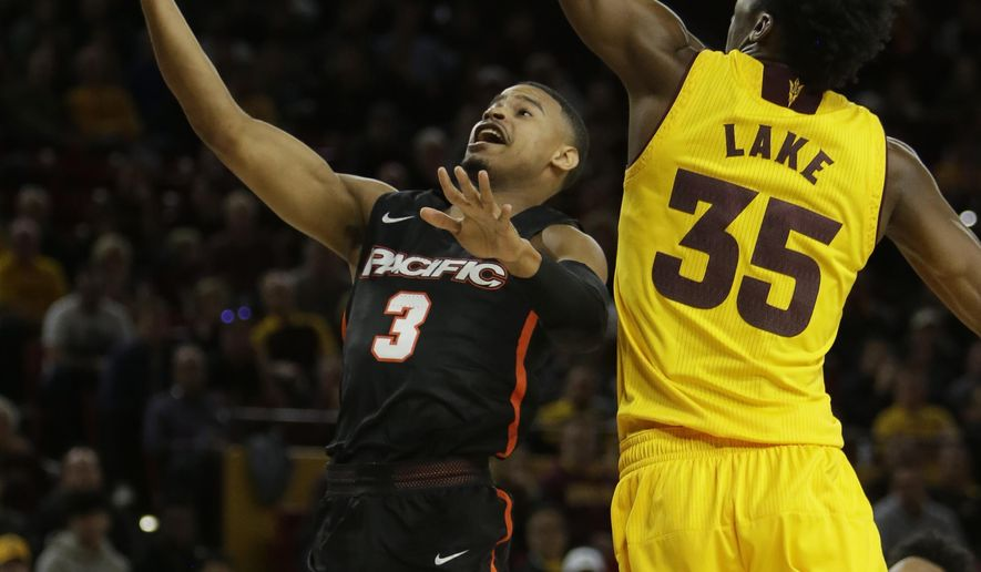 Pacific guard Miles Reynolds, left, drives on Arizona State forward De'Quon Lake (35) in the first half during an NCAA college basketball game, Friday, Dec 22, 2017, in Tempe, Ariz. (AP Photo/Rick Scuteri)