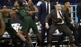 Portland State players and coaches react after center Ryan Edwards dunked against California during the second half of an NCAA college basketball game in Berkeley, Calif., Thursday, Dec. 21, 2017. Portland State won 106-81. (AP Photo/Jeff Chiu)