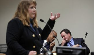 Plaintiff's attorney Michele Earl-Hubbard addresses Thurston County Superior Court as defense attorneys Paul Lawrence, right, and Nick Brown confer behind during a hearing on a lawsuit filed against the Washington Legislature by a coalition of news media organizations over records access, Friday, Dec. 22, 2017, in Olympia, Wash. Judge Chris Lanese is weighing the case that will determine whether the Legislature is fully subject to the state's public records act. Lanese heard arguments for more than two hours Friday in a key hearing in the case brought by a coalition of news organizations led by The Associated Press, who sued in September. (AP Photo/Elaine Thompson)