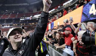 FILE - In this Dec. 2, 2017, file photo, Georgia head coach Kirby Smart celebrates after the Bulldogs defeated Auburn 28-7 in the Southeastern Conference championship NCAA college football game in Atlanta. In only his second season as coach, Smart has Georgia 2 wins from first national championship since 1980. (AP Photo/David Goldman, File)
