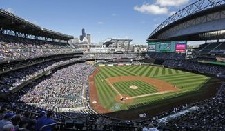 FILE - In this Sept. 21, 2016, file photo, the Seattle Mariners play the Toronto Blue Jays in a baseball game at Safeco Field in Seattle. Big league teams in Texas, Florida, Nevada and Washington state may have become more attractive destinations for free agents following the enactment of tax law changes. The new law that takes effect next year caps deductions for state and local taxes at $10,000 for married couples filing jointly. That has a huge impact for athletes with seven- and eight-figure salaries. (AP Photo/Elaine Thompson, File)