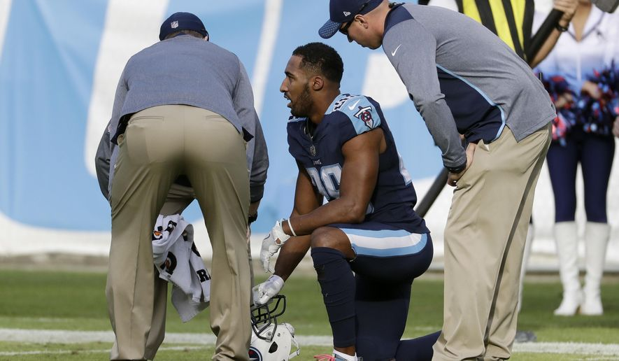 FILE - In this Sunday, Dec. 3, 2017, file photo ,Tennessee Titans defensive back Logan Ryan (26) is attended to after getting injured in the second half of an NFL football game against the Houston Texans in Nashville, Tenn. The Titans already are without one of their cornerbacks and could be without a starter Logan Ryan on Sunday against the Los Angeles (AP Photo/James Kenney, File)