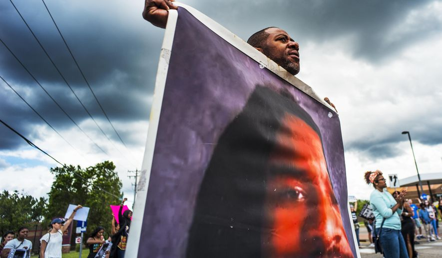 In this June 18, 2017 file photo, John Thompson, who said he was a close friend of Philando Castile, protests during a demonstration in St. Anthony, Minn. The protesters marched against the acquittal of Police Officer Jeronimo Yanez, who was found not guilty of manslaughter for shooting Castile during a traffic stop.  (Richard Tsong-Taatarii /Star Tribune via AP, File)  **FILE**