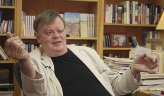 "FILE - In this July 26, 2017 file photo, Garrison Keillor, creator and former host of, ""A Prairie Home Companion,"" talks at his St. Paul, Minn., office. Two of Minnesota's most famous people, Keillor, and Al Franken saw their legacies derailed as sexual misconduct scandals swept the political and entertainment worlds. Minnesota Public Radio fired Keillor in November after a person who formerly worked for him made allegations of inappropriate behavior. His firing is one of Minnesota's top stories in 2017. (AP Photo/Jeff Baenen, File)"