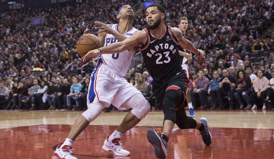 Toronto Raptors' Fred VanVleet, right, steals the ball from Philadelphia 76ers Jerryd Bayless during first half NBA basketball action in Toronto on Saturday, Dec. 23, 2017. (Chris Young/The Canadian Press via AP)