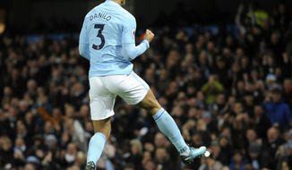 Manchester City's Danilo celebrates scoring his side's fourth goal during the English Premier League soccer match between Manchester City and Bournemouth at Etihad stadium, in Manchester, England, Saturday, Dec. 23, 2017. (AP Photo/Rui Vieira)