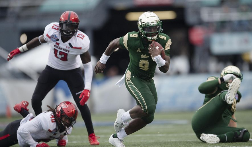 South Florida quarterback Quinton Flowers (9) runs downfield during the first half the Birmingham Bowl NCAA college football game, Saturday, Dec. 23, 2017 in Birmingham, Ala. (AP Photo/Albert Cesare)