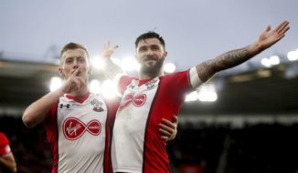 Southampton's Charlie Austin, right, celebrates scoring his side's first goal of the game during the English Premier League soccer match between Southampton and Huddersfied at St Mary's, in Southampton, England, Saturday, Dec. 23, 2017. (Adam Davy/PA via AP)