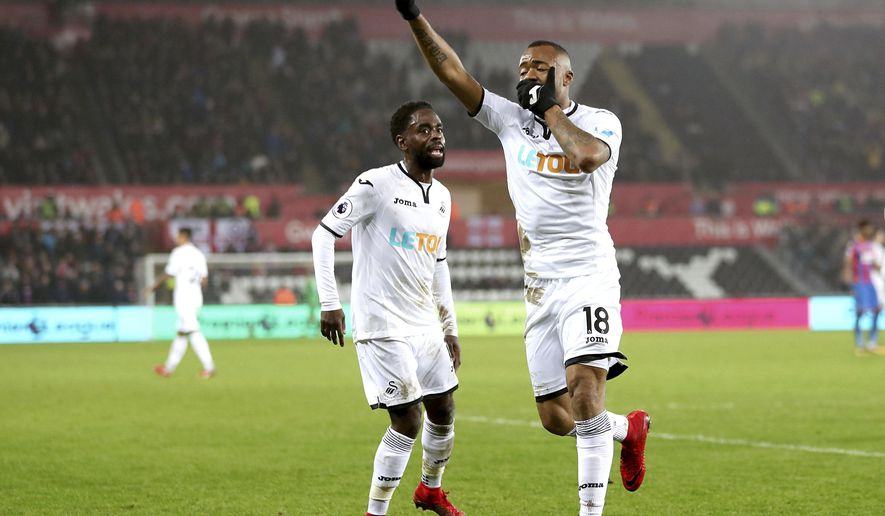 Swansea City's Jordan Ayew celebrates scoring his side's first goal of the game during the English Premier League soccer match against Crystal Palace at the Liberty Stadium, Swansea, England, Saturday, Dec. 23, 2017. (David Davies/PA via AP)