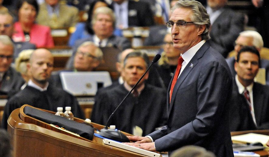 "FILE - In this Jan. 3, 2017, file photo, Republican Gov. Doug Burgum opens North Dakota's 65th legislative assembly in Bismarck, N.D. In his first year as North Dakota's top executive, Burgum hosted the president and vice president, dealt with the biggest civil unrest in state history, admitted to smoking marijuana as a young man, and managed to get sued by the Legislature that's controlled by his own party. The wealthy former software executive, who has donated his state paycheck for substance abuse initiatives, succeeded in being elected governor by running as an outsider vowing to ""reinvent state government."" (Tom Stromme/The Bismarck Tribune via AP, File)"