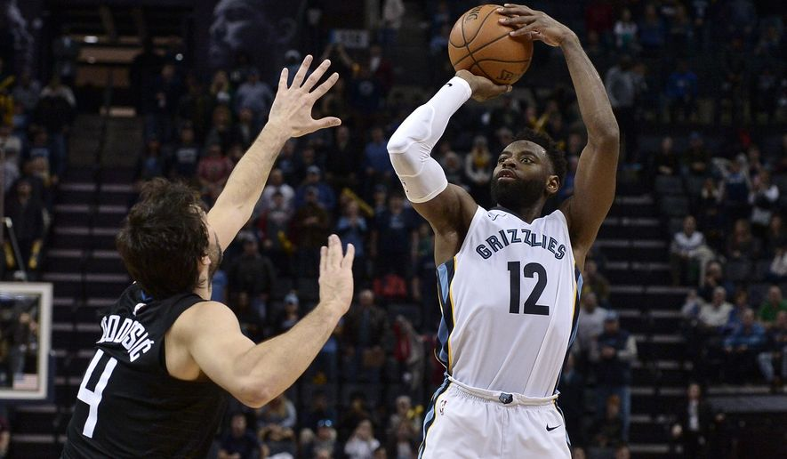 Memphis Grizzlies guard Tyreke Evans (12) attempts a three point shot against Los Angeles Clippers guard Milos Teodosic (4) in the second half of an NBA basketball game Saturday, Dec. 23, 2017, in Memphis, Tenn. The Grizzlies won 115-112. (AP Photo/Brandon Dill)