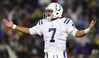 Indianapolis Colts quarterback Jacoby Brissett (7) reacts after his pass to wide receiver T.Y. Hilton (13) is blocked in the closing minutes of an NFL football game against Baltimore Ravens in Baltimore, Saturday, Dec 23, 2017. The Ravens defeated the Colts 23-16. (AP Photo/Gail Burton)