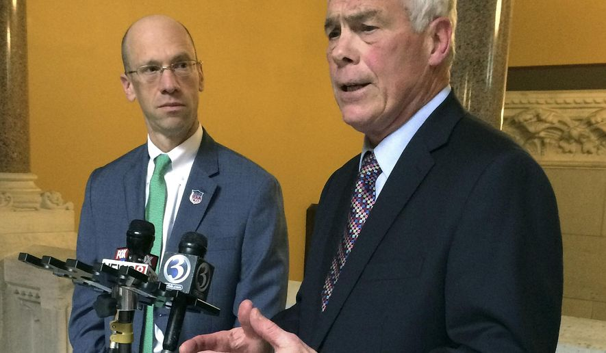 In this Wednesday, Dec. 20, 2017 photo, outgoing MetroHartford Alliance head Oz Griebel, right, announces at the state Capitol in Hartford, Conn., his plan to form an independent ticket for governor in 2018 with his running mate, attorney Monte Frank, left, of Newtown. (AP Photo/Susan Haigh)