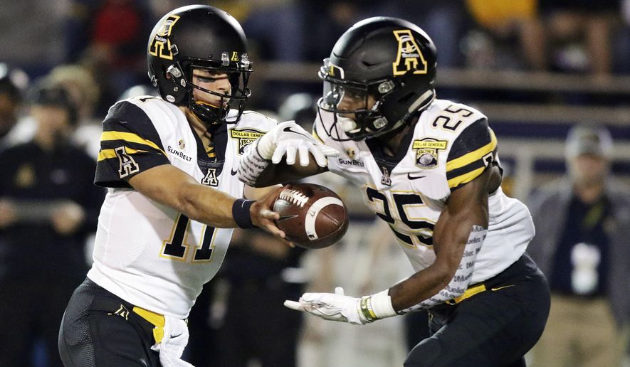 Appalachian State quarterback Taylor Lamb (11) passes the ball to running back Jalin Moore (25) as they play against Toledo in the first half during the Dollar General Bowl NCAA college football game, Saturday, Dec. 23, 2017, in Mobile, Ala. (AP Photo/Dan Anderson)