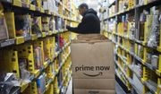 In this Wednesday, Dec. 20, 2017, photo, a clerk reaches to a shelf to pick an item for a customer order at the Amazon Prime warehouse, in New York. (AP Photo/Mark Lennihan) ** FILE **