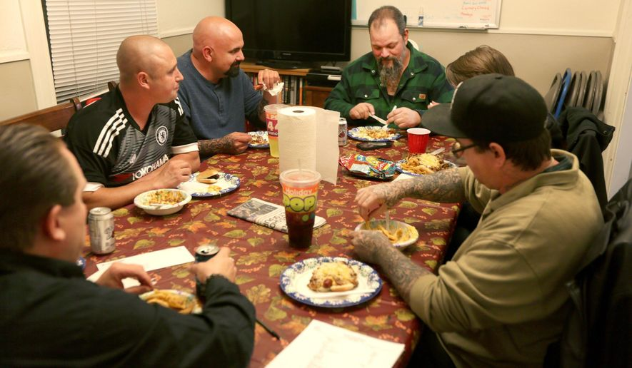 "In this Oct. 3, 2017 photo, several former and current Adullam House residents eat dinner together during the weekly cookout in Billings, Mont.. ""We are up to 127 men that have have lived with me and my wife,"" said Ken Cottrell, Adullam's program director. ""If you were to ask me five-and-a-half years ago would we be this big I'd never would of guess it."" (Bronte Wittpenn/The Billings Gazette via AP)"