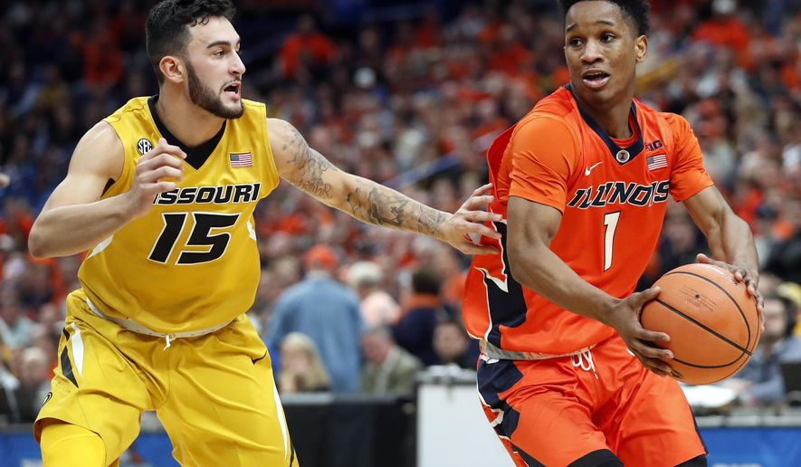 Illinois' Trent Frazier (1) heads to the basket as Missouri's Jordan Geist (15) defends during the first half of an NCAA college basketball game Saturday, Dec. 23, 2017, in St. Louis. (AP Photo/Jeff Roberson)