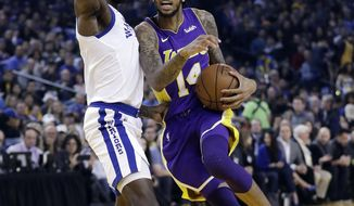 Los Angeles Lakers forward Brandon Ingram, right, drives on Golden State Warriors forward Jordan Bell during the first half of an NBA basketball game Friday, Dec. 22, 2017, in Oakland, Calif. (AP Photo/Marcio Jose Sanchez)