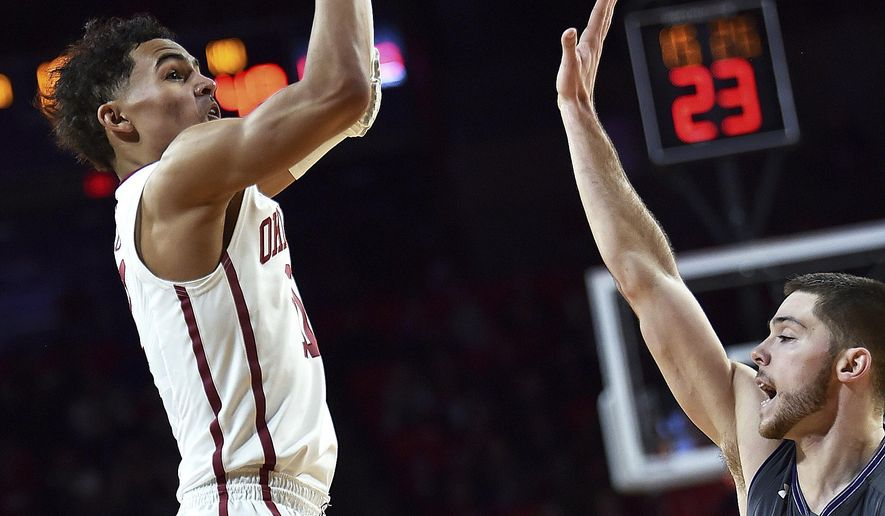 Oklahoma guard Trae Young shoots over Northwestern guard Bryant McIntosh during the second half of an NCAA college basketball game in Norman, Okla., Friday, Dec. 22, 2017. Oklahoma won 104-78. (AP Photo/Tyler Drabek)
