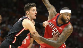 New Orleans Pelicans forward DeMarcus Cousins (0) and Miami Heat guard Goran Dragic (7) battle under the basket for position during the first half of an NBA basketball game, Saturday, Dec. 23, 2017, in Miami. (AP Photo/Joel Auerbach)