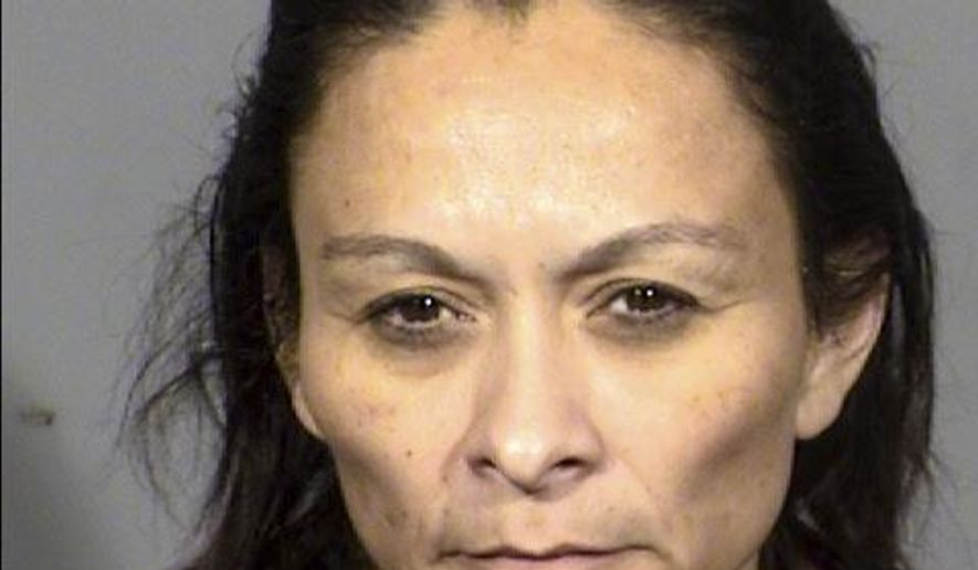 This booking photo provided by Las Vegas Metropolitan Police Department on Saturday, Dec. 23, 2017 shows Christine Sanchez, 47. Sanchez is accused of fatally shooting her three roommates on Dec. 22. (Las Vegas Metropolitan Police Department via The AP)