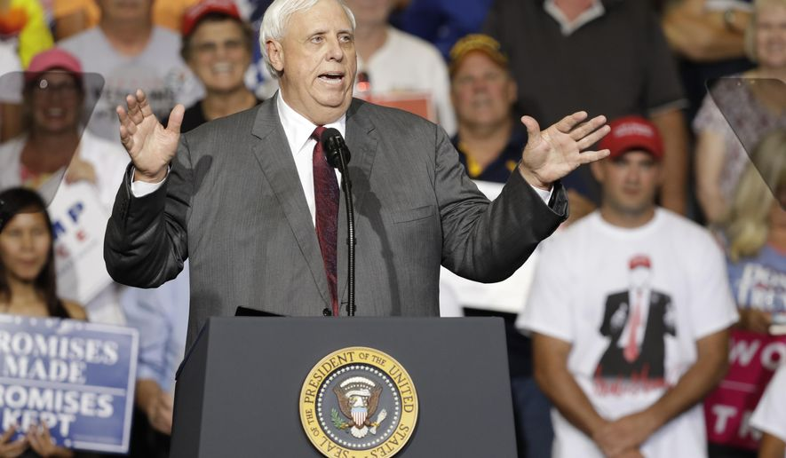 FILE - In a Thursday, Aug. 3, 2017 file photo, West Virginia Gov. Jim Justice speaks during a rally Thursday, Aug. 3, 2017, in Huntington, W.Va. Justice, a Democrat, announced that he is switching parties to join the Republicans. The switch has been voted one of the top stories in West Virginia in 2017. (AP Photo/Darron Cummings, File)