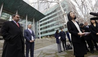 FILE - In this Thursday, Dec. 21, 2017 file photo, Mariko Hirose, right, a litigation director at the Urban Justice Center, speaks to reporters accompanied by Mark Hetfield, president & CEO of HIAS, left, and Rabbi Will Berkowitz, Jewish Family Service of Seattle CEO, in front of a federal courthouse in Seattle. On Saturday, Dec. 23, 2017, U.S. District Judge James Robart partially lifted a Trump administration ban on certain refugees after the American Civil Liberties Union and Jewish Family Service argued that the policy prevented people from some mostly Muslim countries from reuniting with family living legally in the United States. (AP Photo/Elaine Thompson)