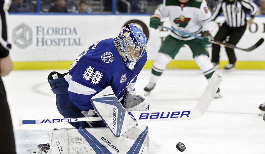 Tampa Bay Lightning goalie Andrei Vasilevskiy (88) makes a save on a shot by the Minnesota Wild during the first period of an NHL hockey game Saturday, Dec. 23, 2017, in Tampa, Fla. (AP Photo/Chris O'Meara)