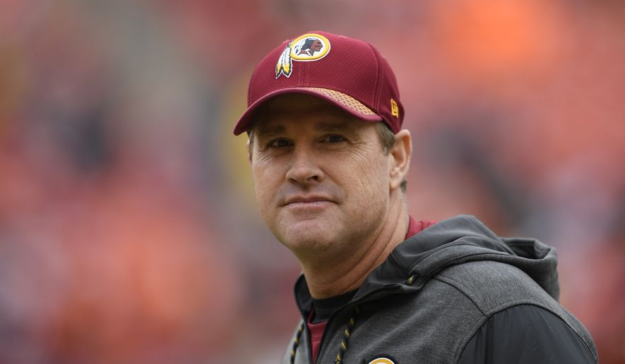 Washington Redskins head coach Jay Gruden walks across the field before an NFL football game against the Denver Broncos in Landover, Md., Sunday, Dec 24, 2017. (AP Photo/Nick Wass)